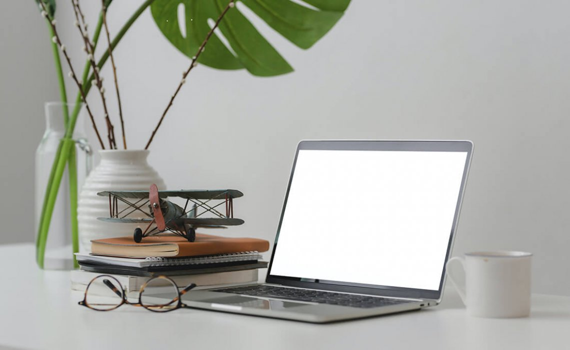 Small - macbook-pro-on-white-table-3816195